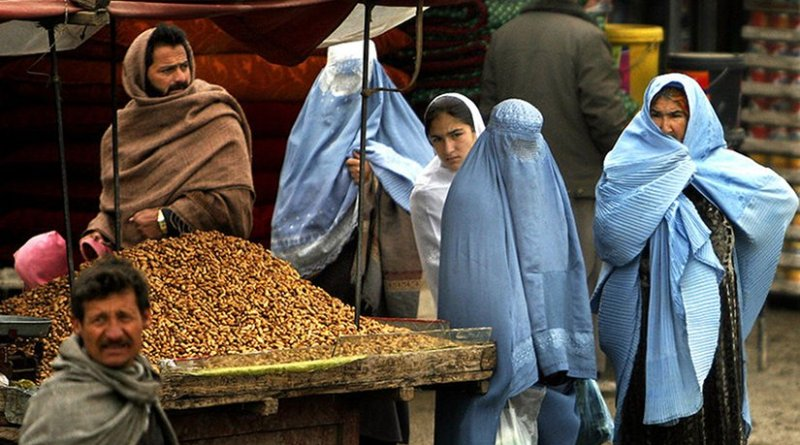 Women in Afghanistan market. Photo by Staff Sgt. Russell Lee Klika, US Army National Guard, Wikimedia Commons.