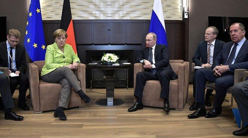 Russia's President Vladimir Putin meets Chancellor of the Federal Republic of Germany Angela Merkel at his Sochi residence. Photo Credit: Kremlin.ru