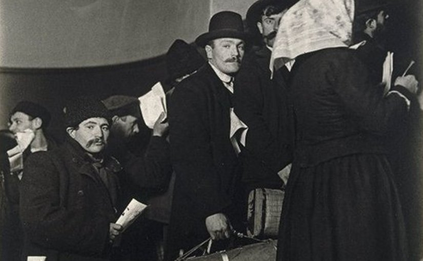 Immigrants arriving at Ellis Island, New York, circa 1908. Photo by Lewis Hine, Wikipedia Commons.