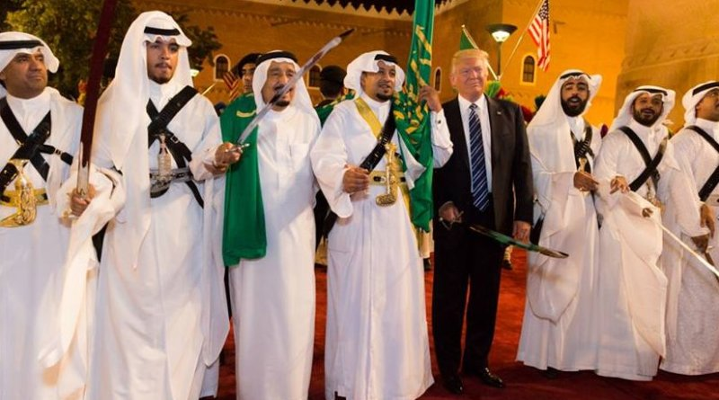 President Donald Trump poses for photos with ceremonial swordsmen on his arrival to Murabba Palace, as the guest of King Salman bin Abdulaziz Al Saud of Saudi Arabia, Saturday evening, May 20, 2017, in Riyadh, Saudi Arabia. (Official White House Photo by Shealah Craighead)