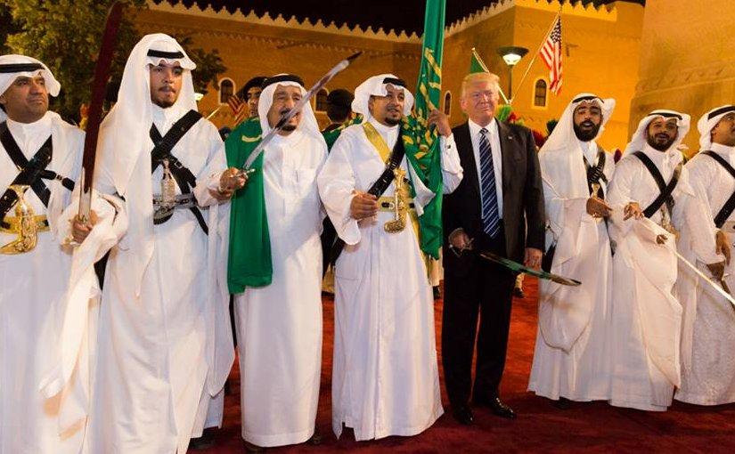 President Donald Trump poses for photos with ceremonial swordsmen on his arrival to Murabba Palace, as the guest of King Salman bin Abdulaziz Al Saud of Saudi Arabia, Saturday evening, May 20, 2017, in Riyadh, Saudi Arabia. (Official White House Photo by Shealah Craighead)