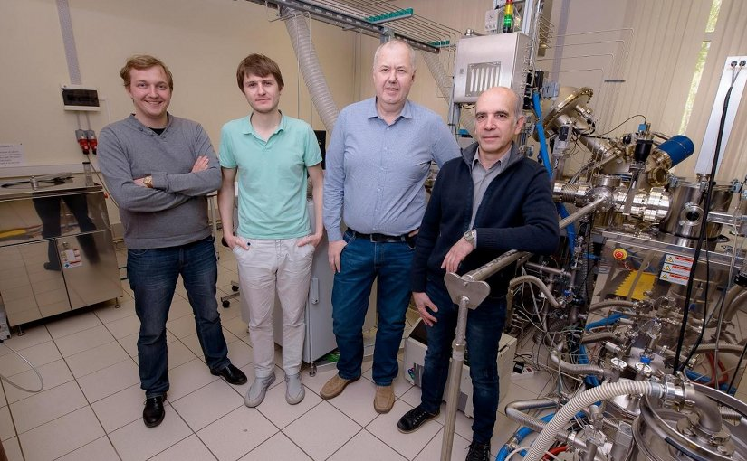 (From left) Dmitry Kuzmichev, Konstantin Egorov, Andrey Markeev, and Yury Lebedinskiy posing next to the atomic layer deposition apparatus at the Center of Shared Research Facilities, MIPT Credit MIPT's Press Office