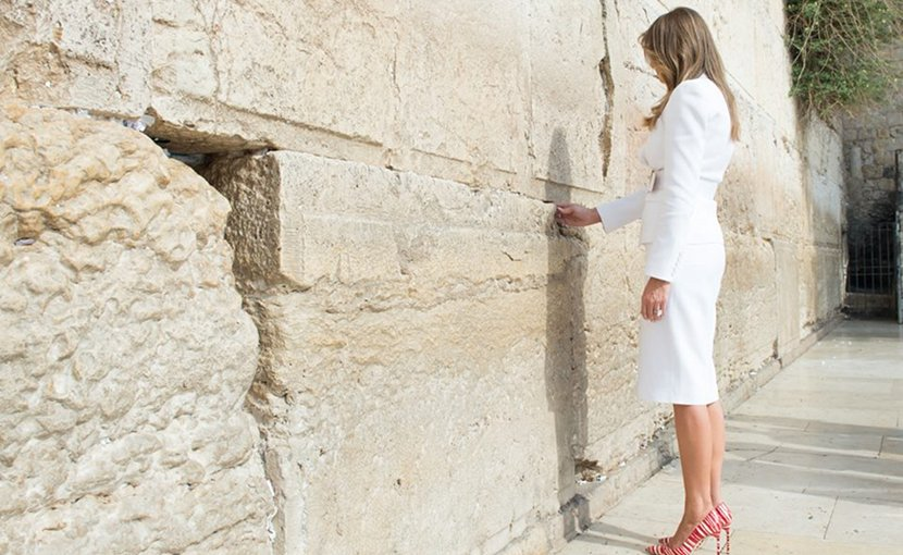 First Lady Melania Trump places a prayer in-between the stone blocks of the Western Wall during an official visit, Monday, May 22, 2017, in Jerusalem. (Official White House Photo by Andrea Hanks)