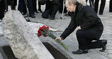 President of Russia Vladimir Putin lays flowers, on 1 February 2008, at the memorial to the victims of the Novocherkassk massacre. Photo Credit: Kremlin.ru, Wikipedia Commons.
