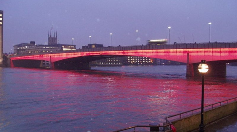 London Bridge illuminated at dusk. File photo by burge5000, Wikipedia Commons.