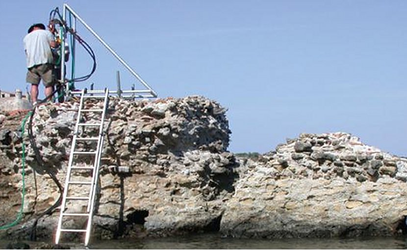 Samples from this Ancient Roman pier, Portus Cosanus in Orbetello, Italy, were studied with X-rays at Berkeley Lab. Credit J.P. Oleson