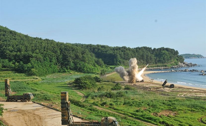 An M270 Multiple Launch Rocket System from 1st Battalion, 18th Field Artillery Regiment, 210th Field Artillery Brigade, 2nd Republic of Korea/United States Combined Division, fires an MGM-140 Army Tactical Missile into the Sea of Japan, July 5, 2017. In the foreground, two mobile carriers prepare to launch South Korean Hyunmoo II missiles. The missile launches demonstrated the combined deep strike capabilities which allow the South Korean-U.S. alliance to neutralize hostile threats and aggression against South Korea, the U.S. and other allies. Army photo