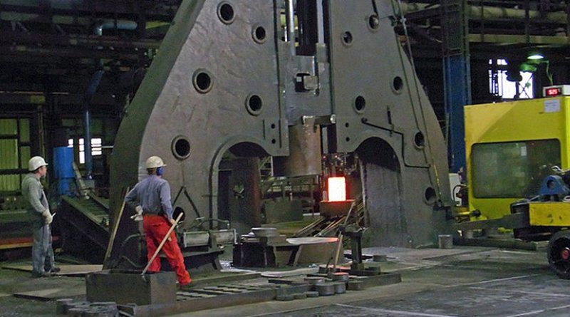 Hot metal ingot being loaded into a hammer forge. Photo by Rainer Halama, Wikipedia Commons.