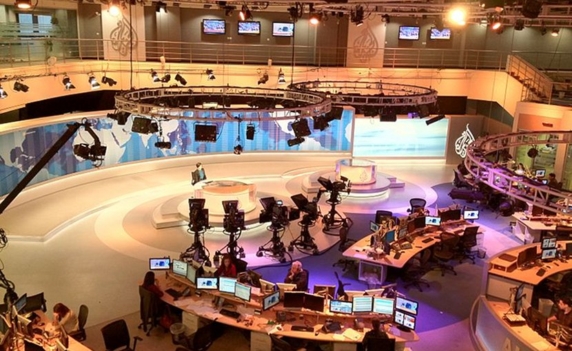 Photo from balcony overlooking Al Jazeera's main television studio towards presenter's desk in the Doha, Qatar headquarters. Photo by Wittylama, Wikimedia Commons.