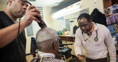 Dr. Joseph Ravenell talks to patrons of a New York City barbershop Credit NYU Langone Health