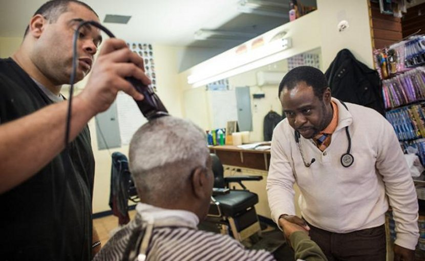Dr. Joseph Ravenell talks to patrons of a New York City barbershop Credit NYU Langone Health