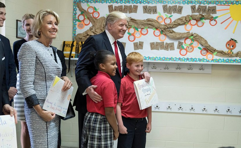 US President Donald Trump with schoolchildren. Photo Credit: White House