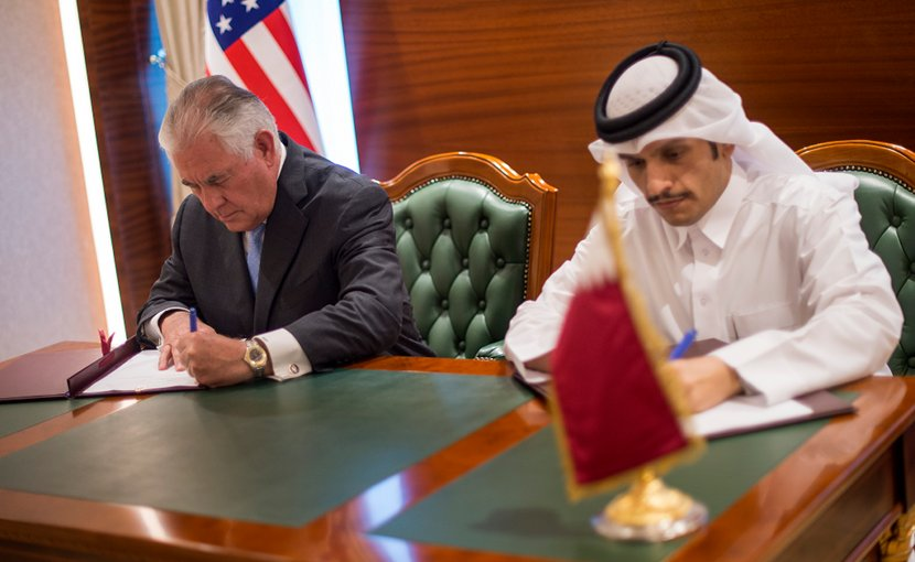 U.S. Secretary of State Rex Tillerson and the Qatari Minister of Foreign Affairs Sheikh Mohammed bin Abdulrahman Al Thani sign an MOU in Doha, Qatar on July 11, 2017. [State Department photo/ Public Domain]