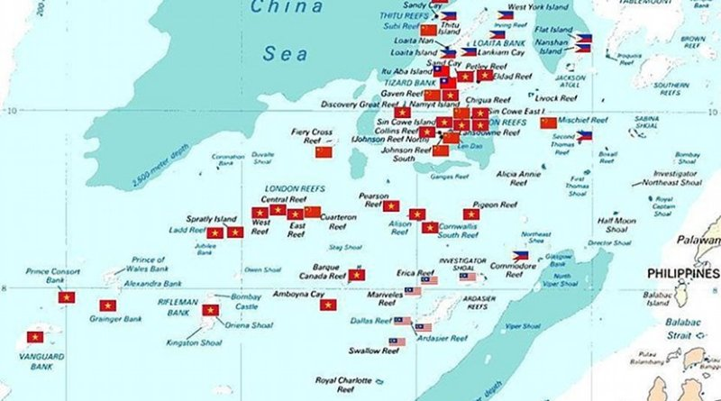 Spratly islands map showing occupied features marked with the flags of countries occupying them. Source: Wikipedia Commons