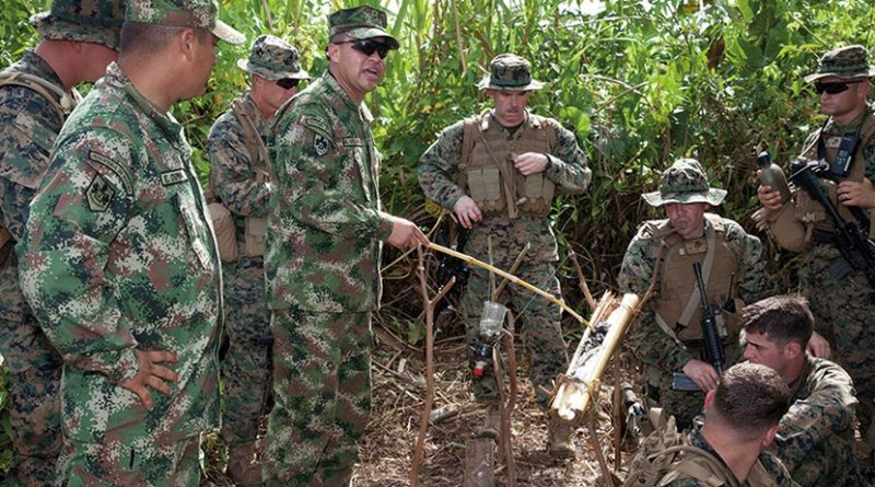 Colombian naval infantrymen explain their water purification and jungle survival techniques to U.S. Marines during Amphibious-Southern Partnership Station near Turbo, Colombia, October 10, 2011 (U.S. Army/Juancarlos Paz)