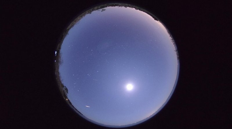 A bright member of the Phoenicid meteor shower appears at the bottom left of this photo taken at 02h15m39s UT on December 2, 2014. The Moon is captured to the lower right of center in the photo. Camera: Pentax K-3 + SIGMA 4.5mm F2.8, 3 second exposure time, at Sandy Point, North Carolina, U.S.A.. (Photo: Hiroyuki Toda) Credit NAOJ
