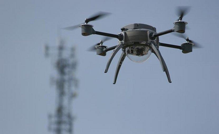 Aeryon Scout UAV (drone) in flight. Photo by Dkroetsch, Wikimedia Commons.