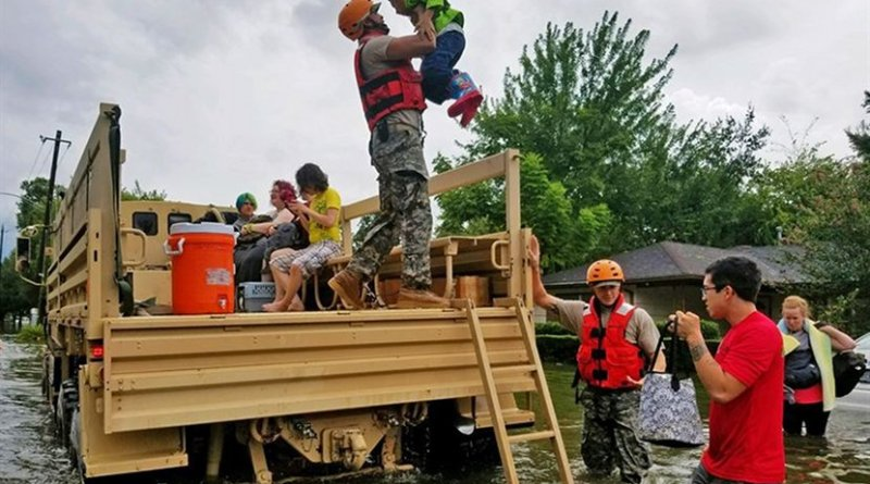 Texas National Guard soldiers assist residents affected by flooding caused by Hurricane Harvey in Houston, Aug. 27, 2017. National Guard photo by Lt. Zachary West