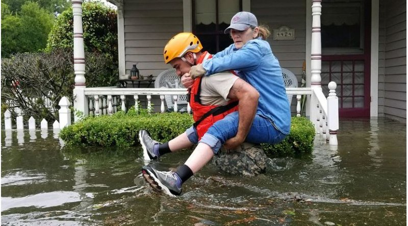 A Texas National Guardsman carries a resident from her flooded home following Hurricane Harvey in Houston, Aug. 27, 2017. President Donald J. Trump, who previously declared a state of emergency in Texas, declared on Aug. 28, 2017, that an emergency exists in the state of Louisiana and ordered federal assistance to supplement state, tribal, and local response efforts due to the emergency conditions resulting from Tropical Storm Harvey. Army National Guard photo by Lt. Zachary West