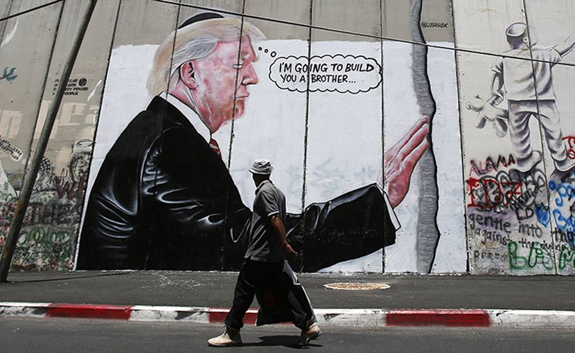 Graffiti resembling that of British street artist Banksy has appeared on Israel's concrete security barrier in the West Bank city of Bethlehem. Photo via MINA.