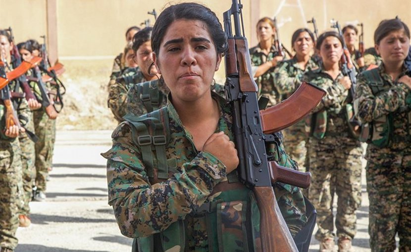 Syrian Democratic Forces trainees, representing an equal amount of Arab and Kurdish volunteers, stand in formation at their graduation ceremony in northern Syria, Aug. 9, 2017. Army photo by Sgt. Mitchell Ryan