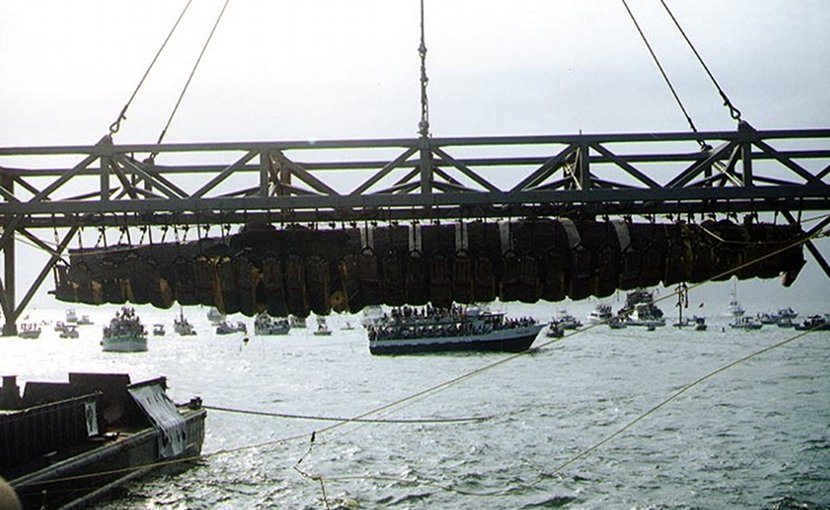 The H. L. Hunley, suspended from a crane during its recovery from off of Charleston Harbor, August 8, 2000. (Photograph from the U.S. Naval Historical Center.)