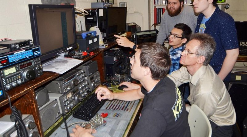 Members of NJIT's ham radio club preparing for the eclipse. From left to right - Nathaniel Frissell, Peter Teklinski, director of Core Systems and Telecommunications for NJIT and club adviser, Spencer Gunning (standing) Joshua Vega (sitting) and Joshua Katz (standing). Credit New Jersey Institute of Technology
