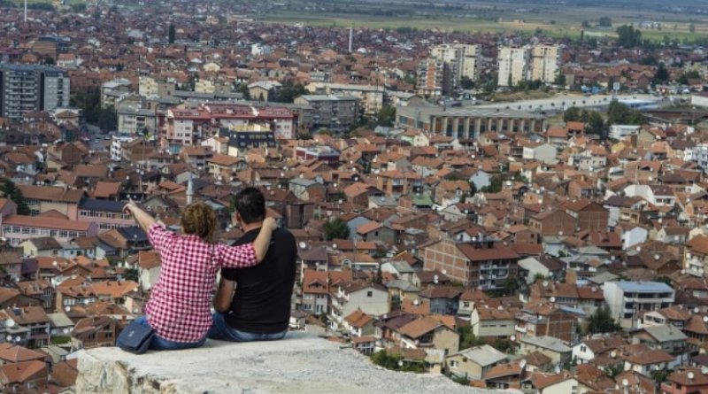 Couple sits above Prizen, Kosovo.