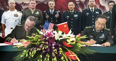 Marine Corps Gen. Joseph F. Dunford Jr., chairman of the Joint Chiefs of Staff, signs the Joint Staff Dialogue Mechanism with his Chinese counterpart Gen. Fang Fenghui following a roundtable discussion at the Ba Yi, Aug. 15, 2017. (DOD photo by U.S. Navy Petty Officer 1st Class Dominique A. Pineiro)