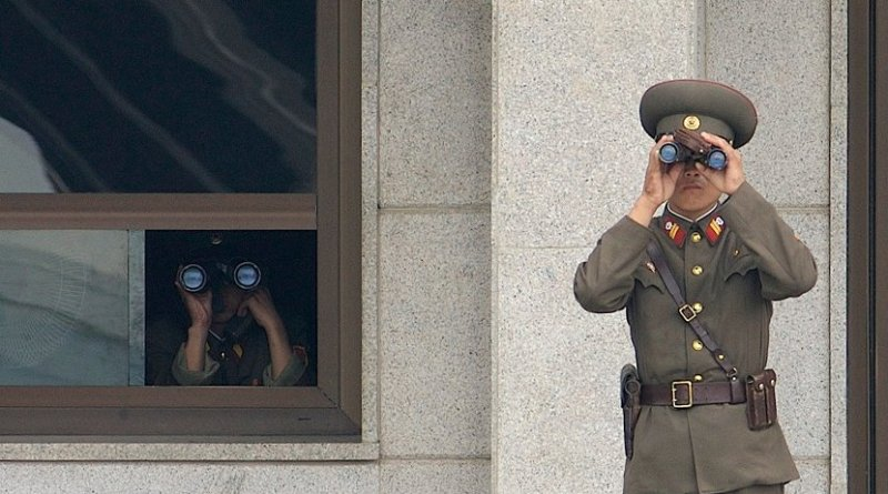 Soldiers from the Korean People's Army look south while on duty in the Joint Security Area. Photo by Edward N. Johnson, US Army, Wikipedia Commons.