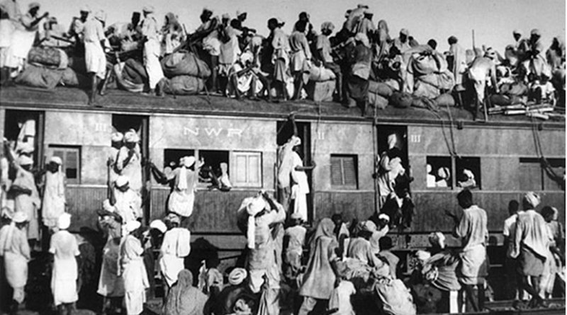 An overcrowded train carrying refugees during the partition of India in 1947. This is considered to have been the largest migration in human history. It forced millions of people to be displaced. Source: Wikipedia Commons.