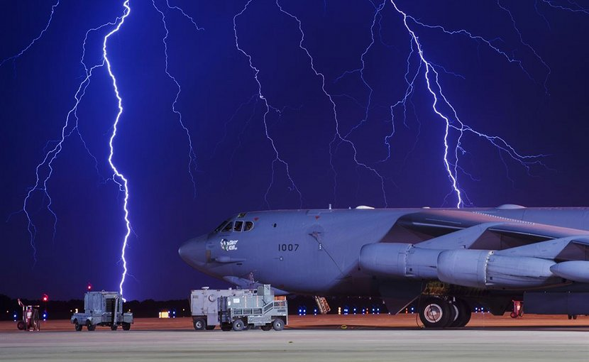 Lightning strikes behind a B-52H Stratofortress at Minot Air Force Base, N.D., Aug. 8, 2017. The B-52 can conduct strategic attacks, close-air support, air interdiction, offensive counter-air and maritime operations. Air Force photo by Senior Airman J.T. Armstrong