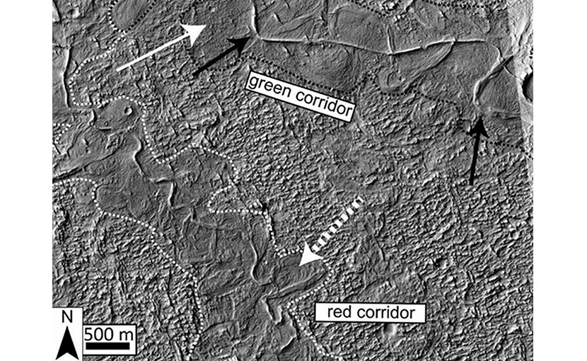The dotted white arrow points to curved strata recording point bar growth and river migration. The boundaries of ancient valley walls are defined by textural and albedo changes and are also associated with lateral river migration. Stacked above the point bars and completely confined within the dotted white and black lines are topographically inverted river deposits outcropping as ridges (e.g., black arrow). In places (e.g., south of the dotted white arrow), the ridges run against the dotted boundaries, suggesting flow was once redirected along a valley wall.