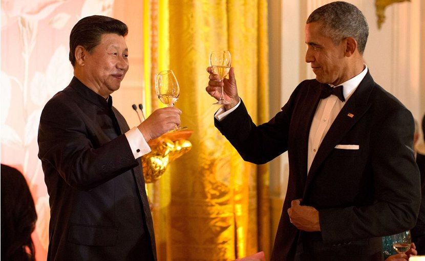 "China's Xi Jinping wearing a ""Mao suit"" at a black tie state dinner with US President Barack Obama. Photo by Pete Souza, White House, Wikipedia Commons."