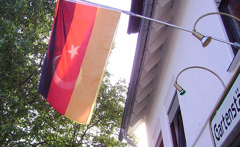 Combination of flags of Germany and Turkey. Photo by Immanuel Giel, Wikimedia Commons.
