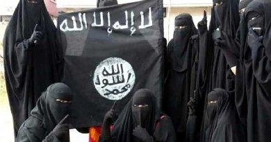 Women holding Islamic State flag.