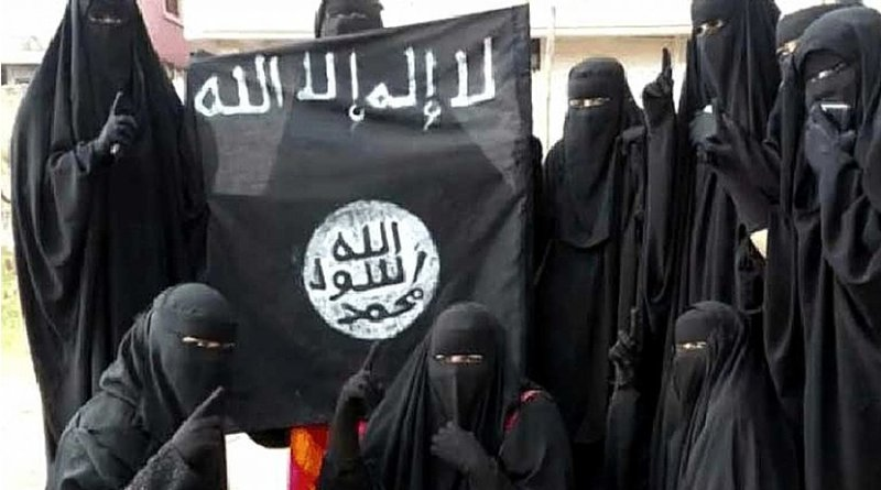 Women holding Islamic State flag.