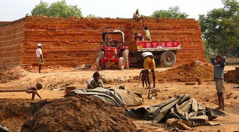 Brick kiln workers in Hyderabad, India. File photo by Apoorva Jinka, Wikimedia Commons.
