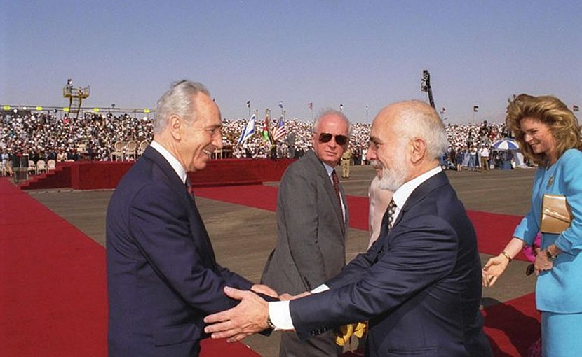 Israel's Foreign Minister Shimon Peres and King Hussein greet each other at the Arava border terminal prior to the signing of the Peace Treaty between their countries. (Government Press Office, Israel)