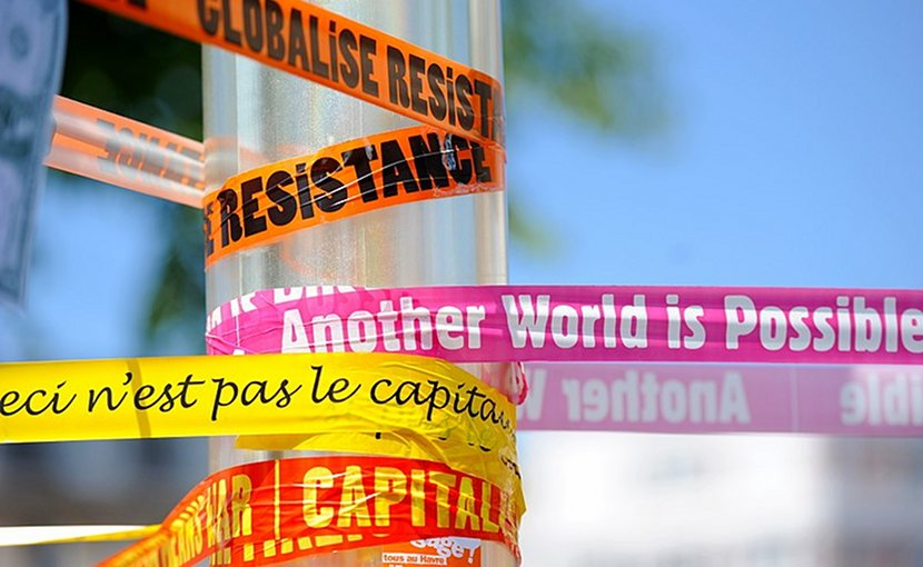 Anti-capitalism and anti-globalization banners. Photo by Guillaume Paumier, Wikimedia Commons.