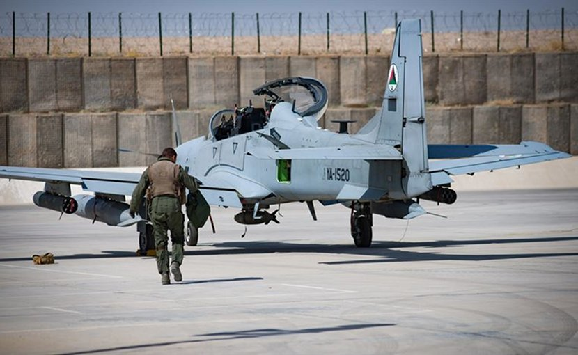 An Afghan A-29 pilot walks toward his aircraft at Kandahar Airfield, Afghanistan. The Afghan air force plans and conducts all A-29 combat missions throughout Afghanistan. Air Force photo by Staff Sgt. Alexander W. Riedel