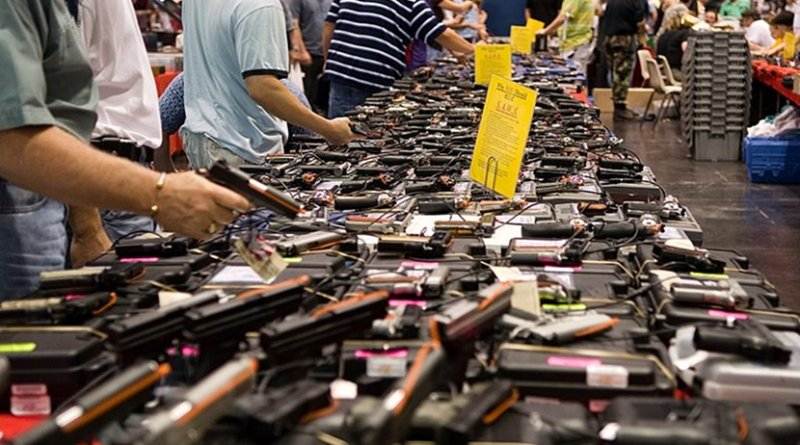 File photo of Houston gun show at the George R. Brown Convention Center. Photo by http://flickr.com/photos/glasgows/, Wikipedia Commons