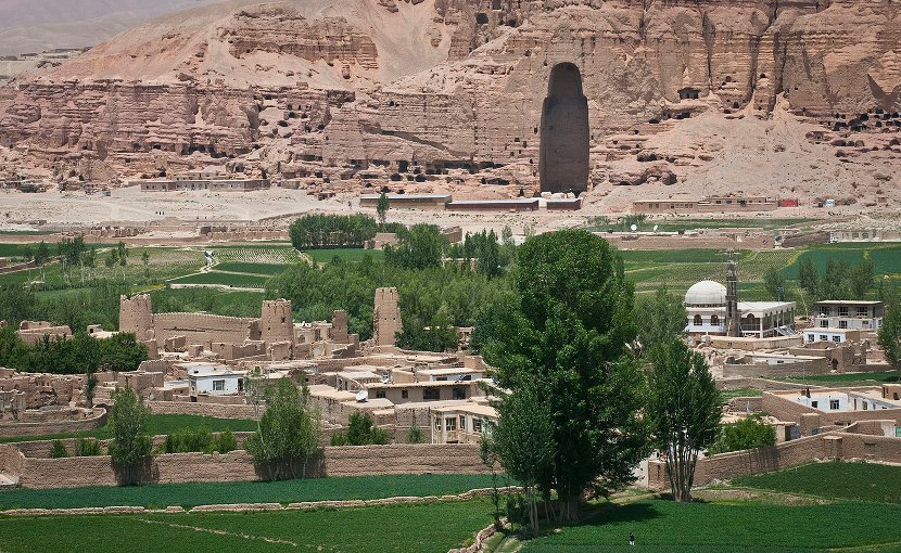 """The cavity where the largest of the Buddha's of Bamiyan statues, known to locals as the """"Father Buddha,"""" used to stand towers above the Bamyan valley, June 16, 2012. The monumental statues were built in A.D. 507 and 554 and were the largest statues of standing Buddha on Earth until the Taliban dynamited them in 2001. Photo Credit: Sgt. Ken Scar, US Army, Wikimedia Commons."""