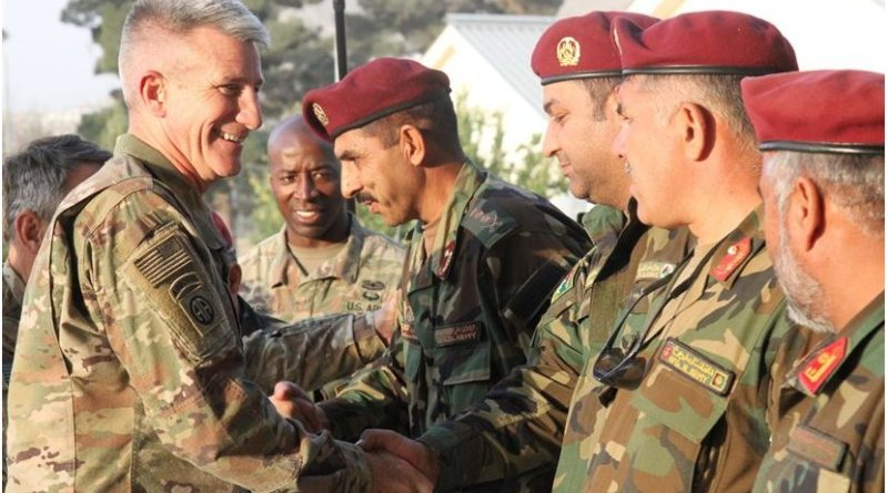 Army Gen. John W. Nicholson, NATO Resolute Support commander, greets Afghan Special Operations Command School of Excellence leaders before receiving an overview of the commando class final tactical exercise and a platoon-level raid demonstration at Camp Command, Kabul, Afghanistan, Oct. 21, 2017. Army photo by Spc. Jacob Krone