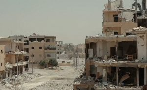 A destroyed part of Raqqa, Syria. Photo by Mahmoud Bali (VOA), Wikimedia Commons.