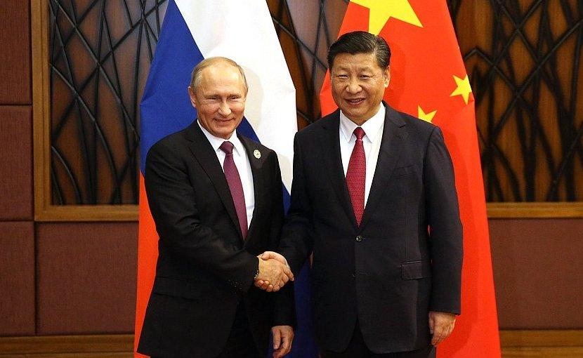 Russia's President Vladimir Putin with President of China Xi Jinping. Photo Credit: Kremlin.ru