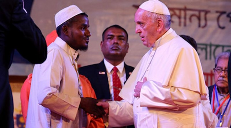 Pope Francis speaks with Muhammad Nurullah, a Rohingya refugee from Myanmar's Rakhine State, during a meeting in Dhaka on Dec. 1. Photo by Joe Torres, Ucanews.com