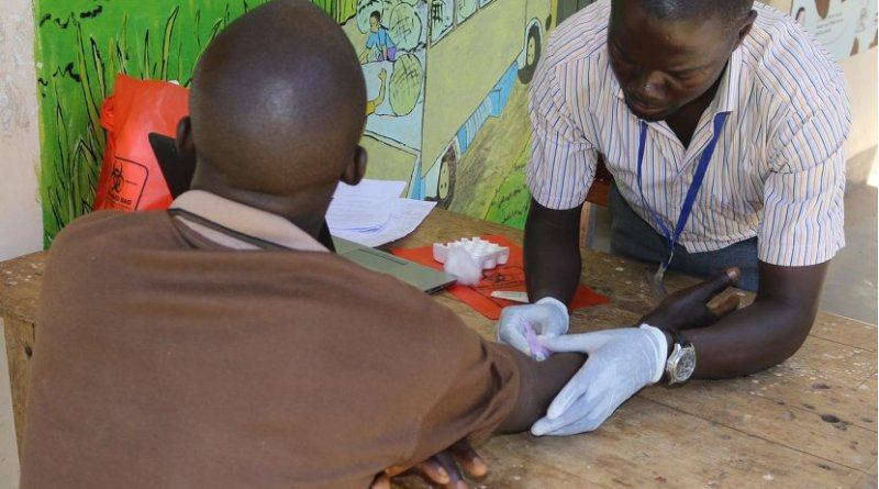 A research assistant draws blood for HIV testing from a participant in the Rakai Community Cohort Study. Credit Rakai Health Sciences Program