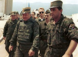 General Ratko Mladic (centre) arrives for UN-mediated talks at Sarajevo airport, June 1993. (Source: Mikhail Evstafiev)