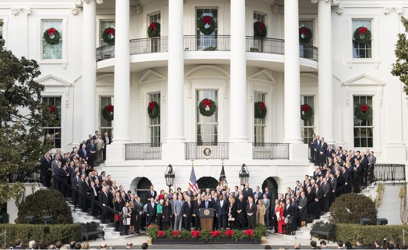 Republicans gather with US President Donald Trump to celebrate passin of tax reform, with White House decorated for Christmas. Photo Credit: White House.